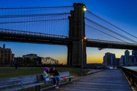 BROOKLYN, NEW YORK, MAR 27, 2018: Brooklyn Bridge, seen from Dumbo Park after sunset, during the  Blue Hour Editoriali