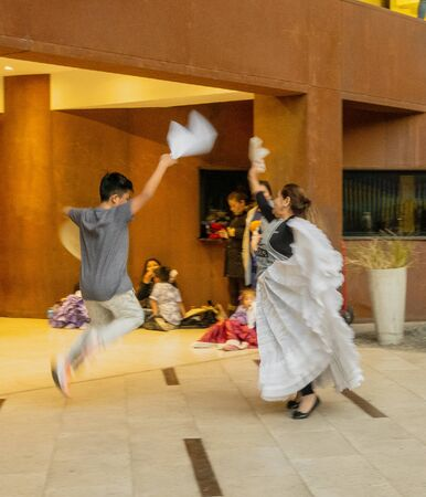 Santiago, Chile - 2019-07-13 - Young couple practices dance performance.