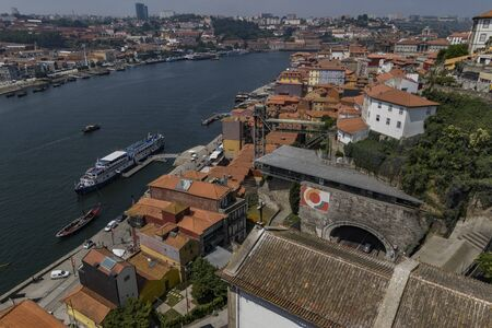 Porto, Portugal - June 21, 2017 - Drone view of Porto with the Duoro river boats plying their trade