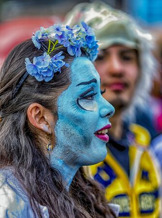 Woman paints her face blue for Fool s Day parade in Cuenca, Ecuador on Jan 6, 2015