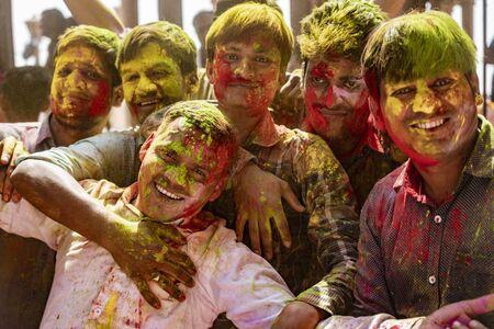 Barsana, India, Holi Festival, Feb 23, 2018 - Group of men pose in full painted glory during Holi Festival in India