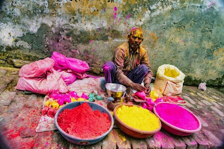 Barsana, India - February 23, 2018 - A man sells paint powder to be thrown by revelers during Holi festival Editoriali
