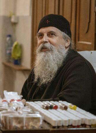 Jerusalem, Israel - 2019-04-26 - orthodox Greek Christian priest talks to person off-camera. Editoriali