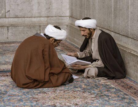 Tehran, Iran - 2019-04-16 - Two holy men study at the Holy Shrine dedicated to Lady Masumeh Fatima. Editoriali