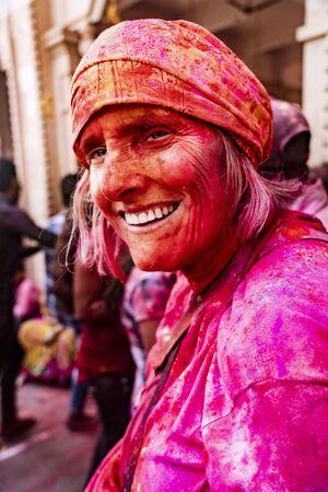 Barsana, India, Holi Festival, Feb 24, 2018 - Woman smiles while covered in paint during Holi Festival in India