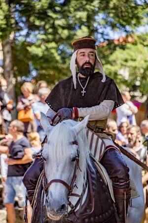 Penedono , Portugal - July 1, 2017 - Man rides horsebase while dressed as a priest in Medieval fair Editoriali