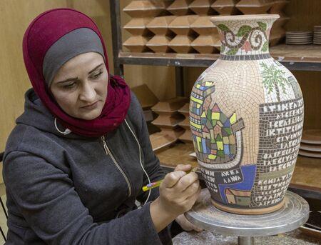 Petra, Jordan - 2019-04-20 - Woman creates intricate mosaic vase.