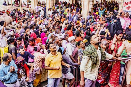 Barsana, India - February 23, 2018 - The crowd waits on the stairs for a temple to open during Holi festival Editoriali