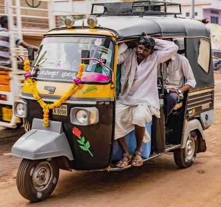 BADAMI, INDIA, MAR 18, 2018: Tuk tuk is overloaded with people