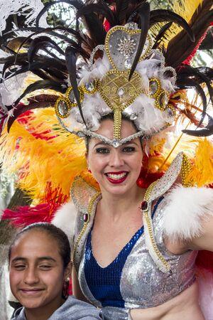 Ambato, Ecuador - Feb 15, 2015 - Beauty Queen Waves to Crowd during Carnaval parade Editoriali