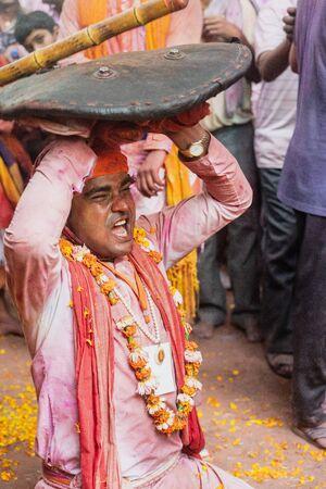 Barsana, India - February 24, 2018 - Lathmar Holi Festival - Women Beat Men With Bamboo Sticks Until Man Gives Up