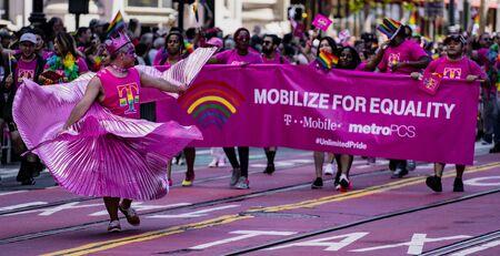 SAN FRANCISCO, CALIFORNIA, JUNE 24, 2018:  GAY PRIDE PARADE - Corporate T-Mobile cellular marches Editoriali