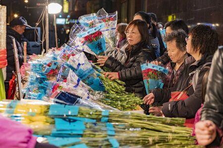 New York City, New York, Feb 14, 2018: Women buy Valentine flowers in New York City