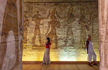Aswan, Egypt - 2019-04-29 - Abu Simbel temple statues and hierglyphs.