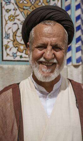 Tehran, Iran - 2019-04-16 - Mulah guide shows off the Holy Shrine dedicated to Lady Masumeh Fatima.