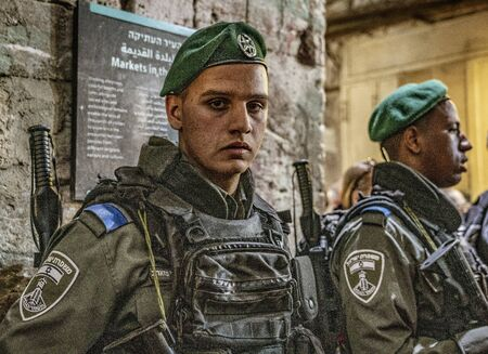 Jerusalem, Israel - 2019-04-26 - Soldiers stand guard at all public places.