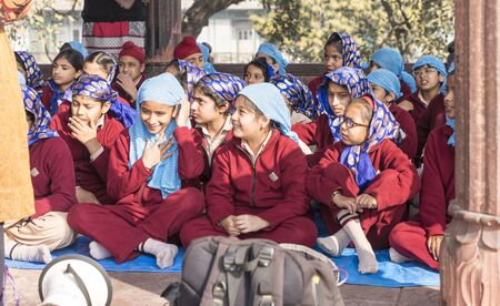New Delhi, India - February 19, 2018 - Children Listen With Various Levels of Attention To Teachers During a School Outing At A Mosque Editoriali