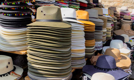 Santa Cruz, Mexico - 2019-11-26 - hats sit in piles to be sold by street vendor. Editorial