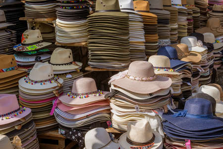 Santa Cruz, Mexico - 2019-11-26 - hats sit in piles to be sold by street vendor.