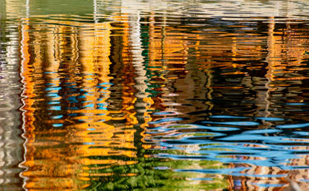 Background pattern from reflections of boats in water