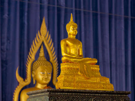 Sitting Golden Buddha in Front of Second Standing Golden Buddha.