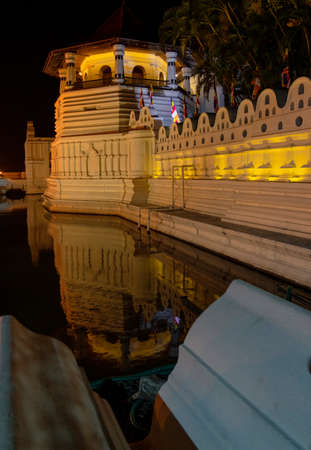 Temple of the Tooth Relic and Reflections Before Dawn in Kandy Sri Lanka.