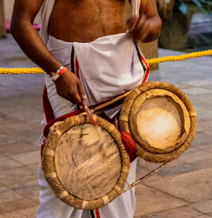 Priest Beats Drums at the Temple of the Tooth Relic in Kandy Sri Lanka.