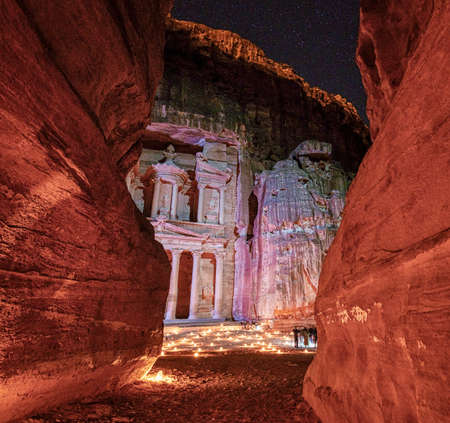 Petra At Night With Candels on Treasury Floor As Seen Through Canyon. Foto de archivo