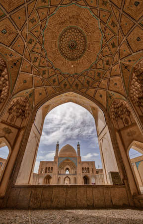 The Aqabozorg Mosque of Kashan Iran in Afternoon Seen Through Arch.