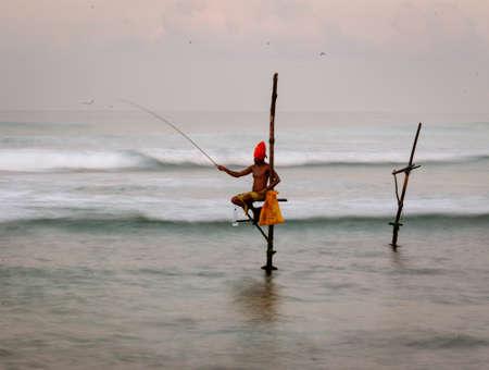 Galle, Sri Lanka - 2019-04-01 - Stilt Fishermen of Sri Lanka Spend All Day on Small Platforms to Catch Fish for Dinner.