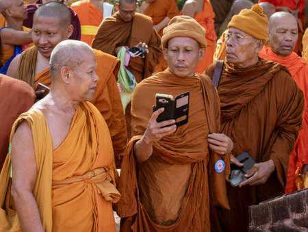 Negombo, Sri Lanka - 2019-03-22 - Monks Gather Together and a Phone Camera Comes Out.