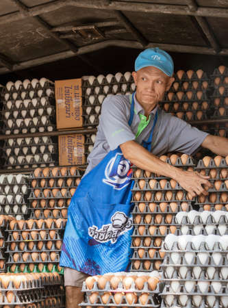 ED-Bankgok, Thailand - 2019-30-13 - Egg Vendor Unloads Cartons From Back of Truck.