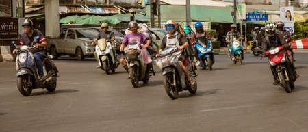 Bangkok, Tahiland - 2019-03-19 - Motorcycles fill the streets of Bangkok and zoom ahead at traffic lights.