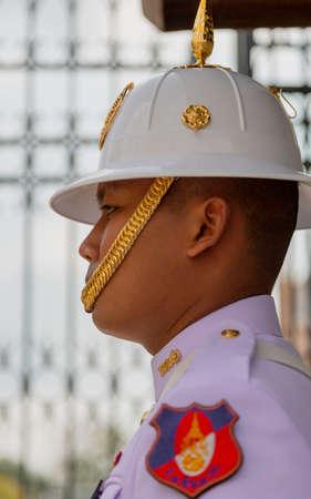 Bangkok, Tahiland - 2019-03-04 - Man Stands Guard at the Grand Palace.
