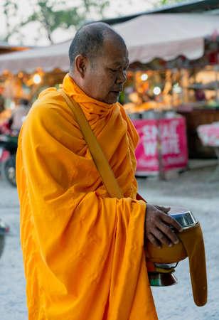 Sukhothai, Tahiland - 2019-03-06 - Monk Walks Asking for Alms.