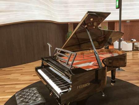 Upright classical piano ready to be played.