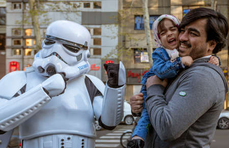 Tehran, Iran - 2019-04-03 - Child is Frightened When Father Hands Him to Star Wars Storm Trooper Character at Street Fair.