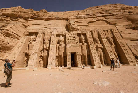 Abu Simbel temple statues and hieroglyphs.