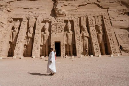 Aswan, Egypt - 2019-04-29 - Abu Simbel temple statues and hierglyphs.