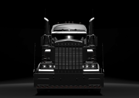 Front view of a long black diesel truck in a dark background