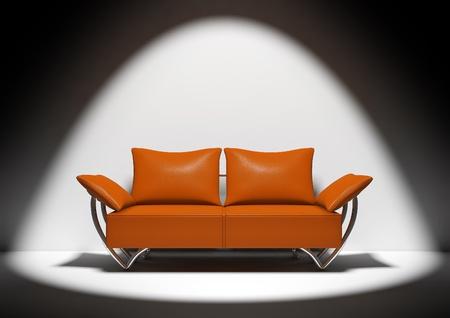 Isolated orange sofa on dark background with spotlight focus