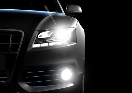 headlight: Front view of luxury car in a black background