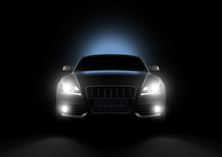 black car: Front view of luxury car in a black background