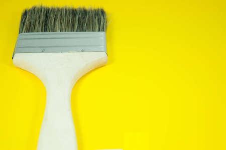 Paint brush on yellow background
