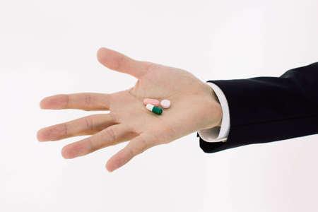 pills on mens hand  Stock Photo