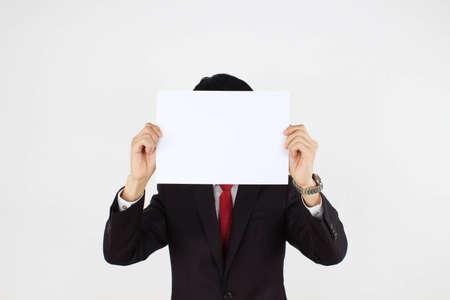 men holding white paper