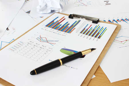 reports and pencil Stock Photo