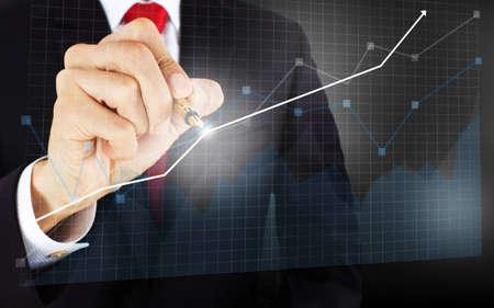 registros contables: empresarios dibujar un gráfico Foto de archivo