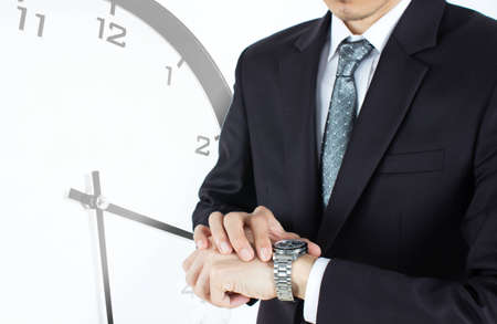 Businessmen looking at his watch