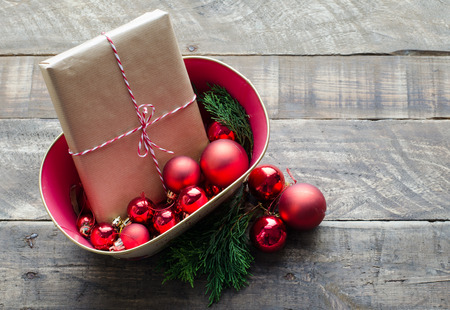 Christmas gifts in basket with red balls. Stock Photo